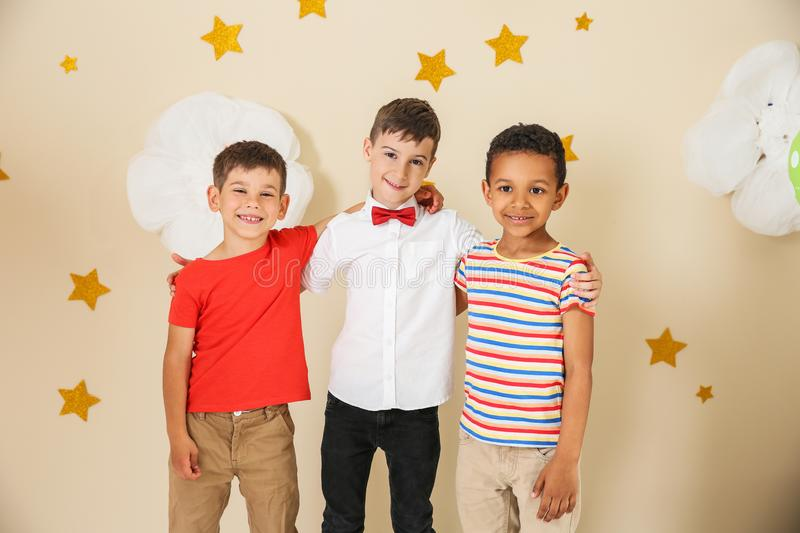 Adorable little boys and decor for birthday party royalty free stock photos