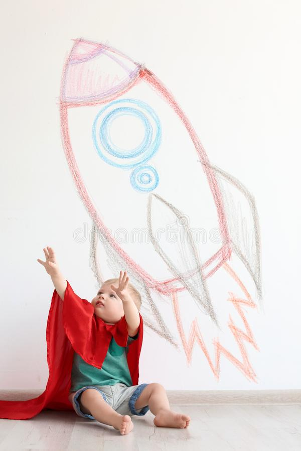 Adorable little child playing astronaut stock image