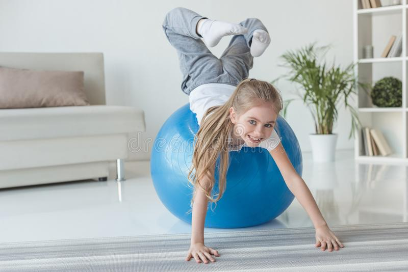 adorable little child playing with fit ball royalty free stock photography