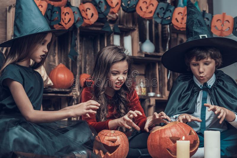 Adorable Little Children in Halloween Costumes royalty free stock photo