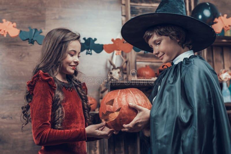 Adorable Little Children in Halloween Costumes stock photo