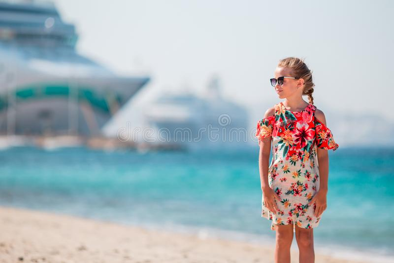 Little girl in european town outdoors on Mykonos island stock photography