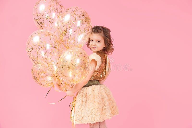 Adorable girl with balloons stock photo