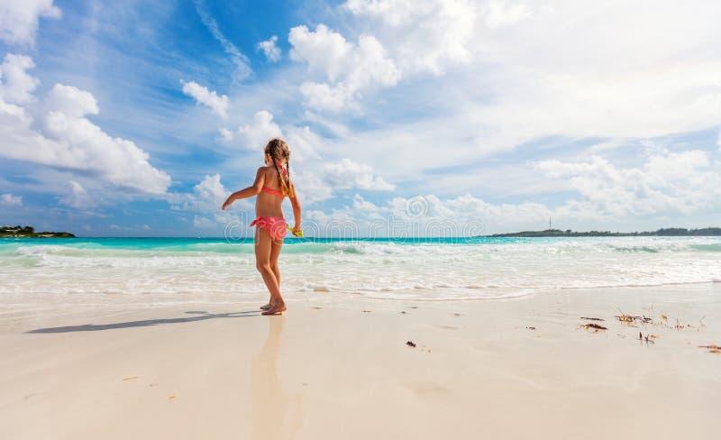 Adorable little girl at beach stock photo