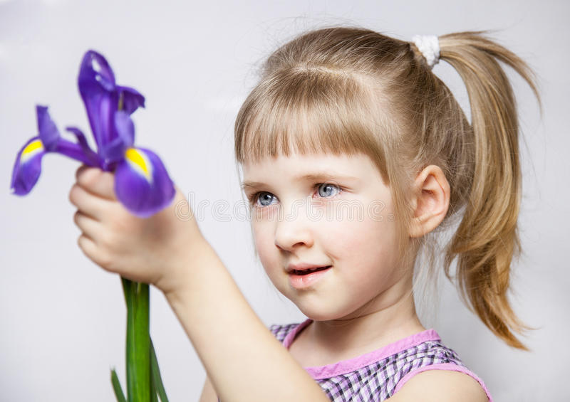 Adorable little girl with beautiful iris royalty free stock images