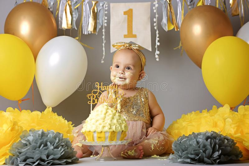 Adorable little girl with birthday cake stock photography