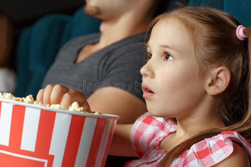 Adorable little girl at the cinema stock photography