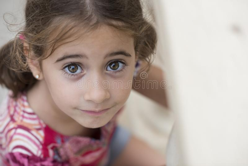 Adorable little girl combed with pigtails royalty free stock photos