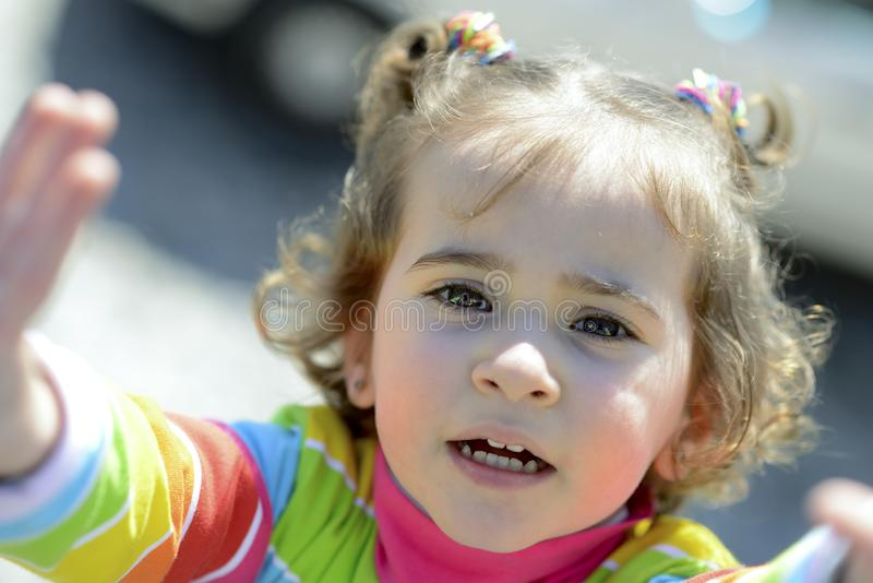 Adorable little girl combed with pigtails stock images