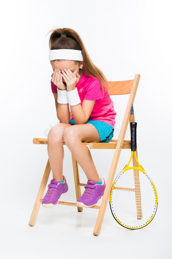 Cute little girl with tennis racket on white background royalty free stock image