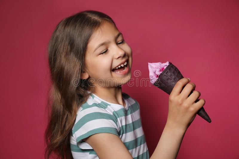 Adorable little girl with delicious ice cream stock photo