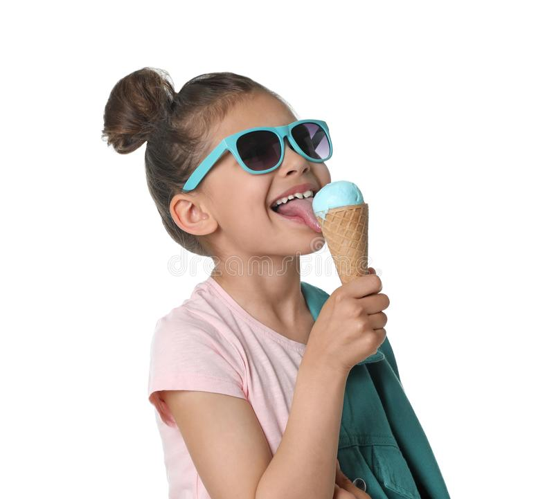 Adorable little girl with delicious ice cream on white royalty free stock photography
