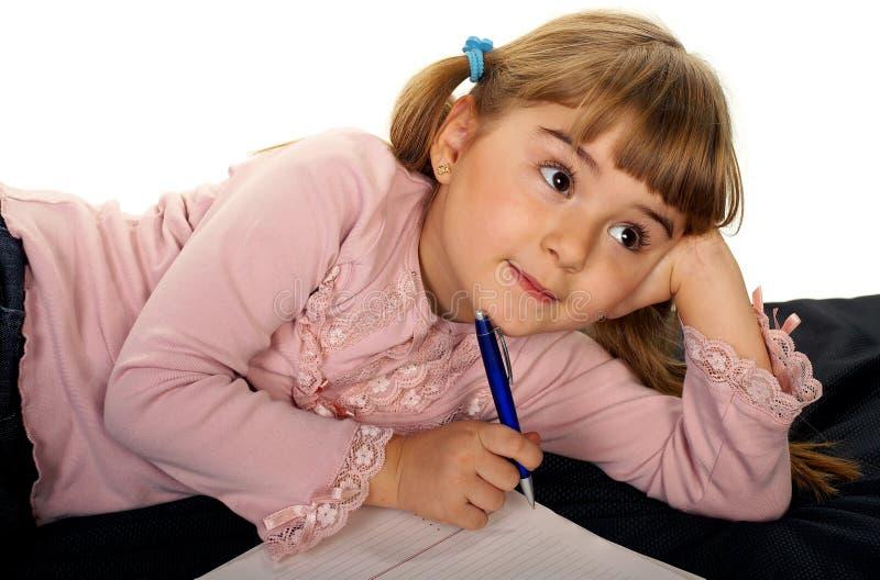 Adorable little girl doing homework royalty free stock photography