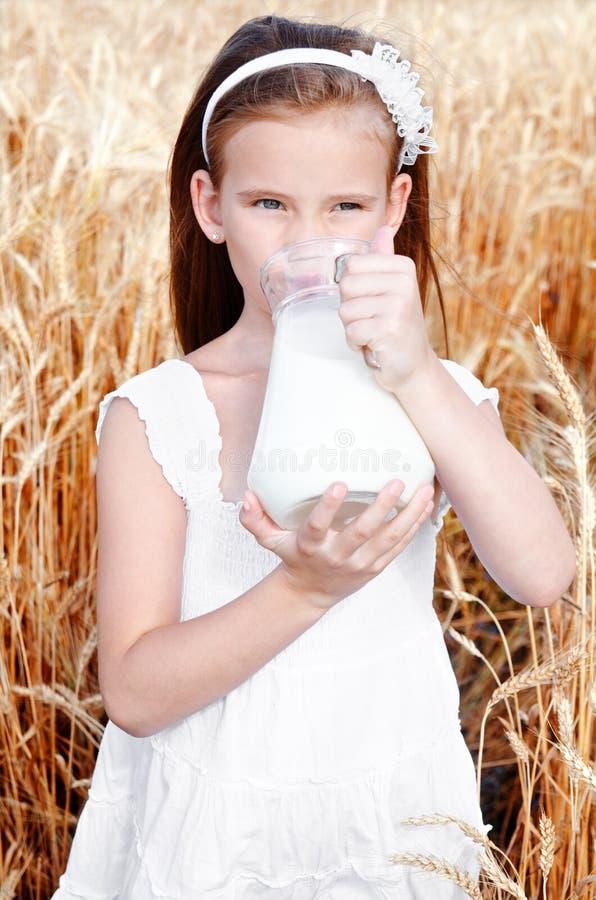 Free Adorable Little Girl Drinking Milk On Field Of Wheat Stock Photo - 74595300