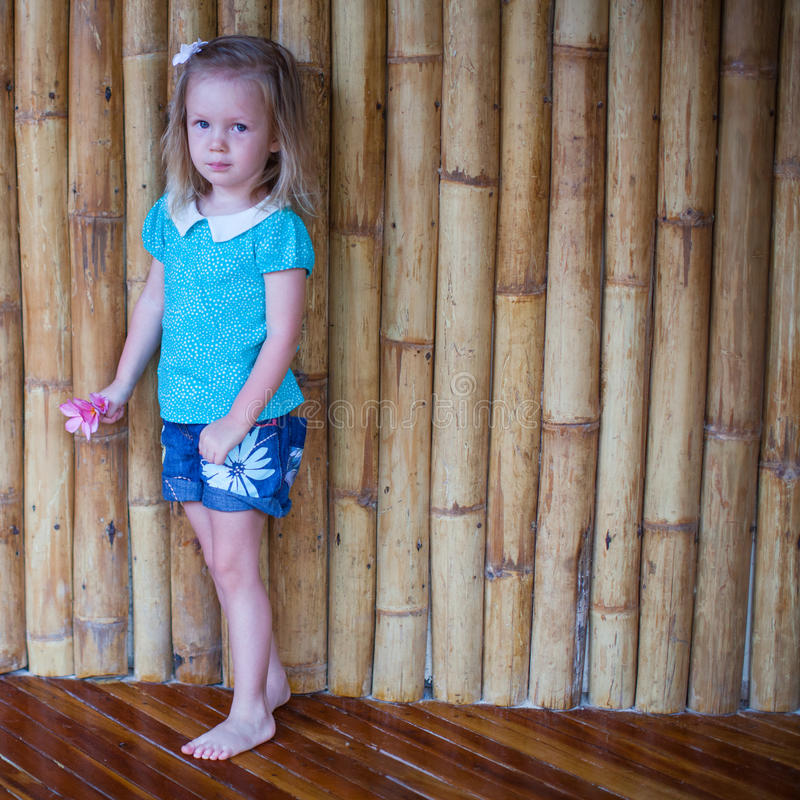 Adorable little girl in exotic tropical resort. This image has attached release stock photos