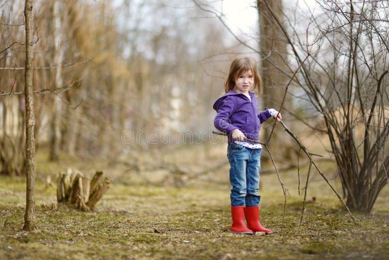 Adorable little girl having fun at spring royalty free stock photo