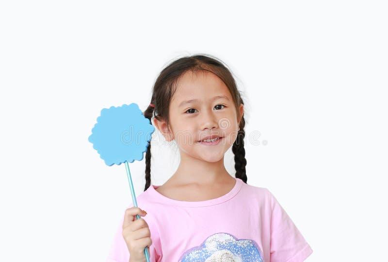Adorable little girl holding shaped magic wand isolated on white background royalty free stock images