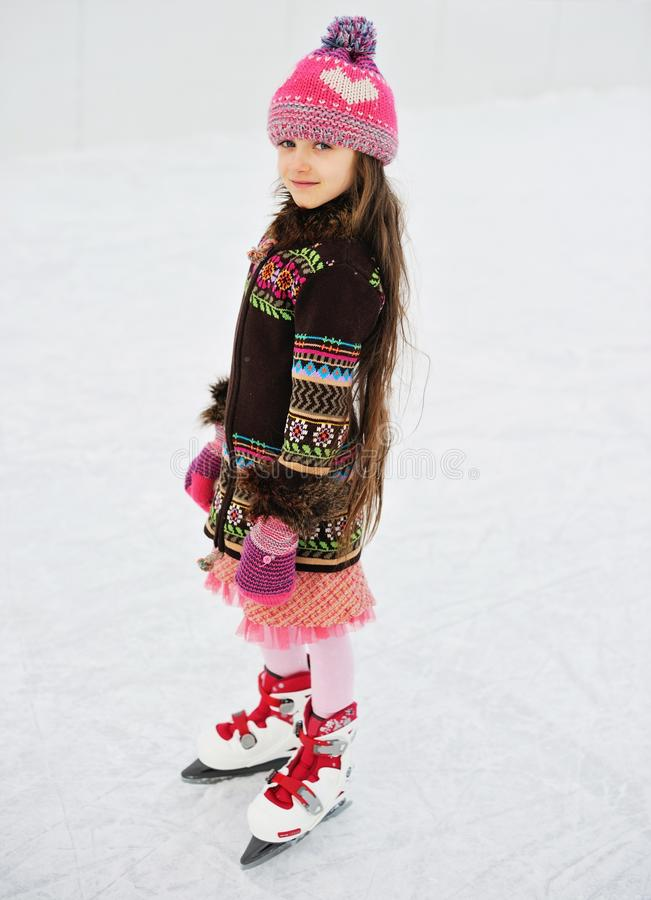 Adorable little girl on the ice rink royalty free stock images