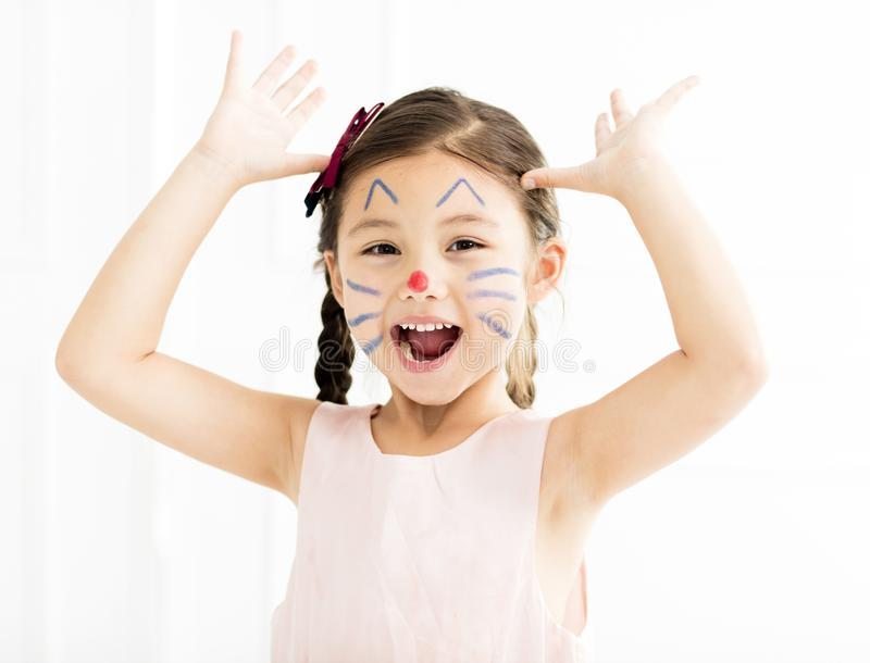 little girl with kitty painted face royalty free stock image