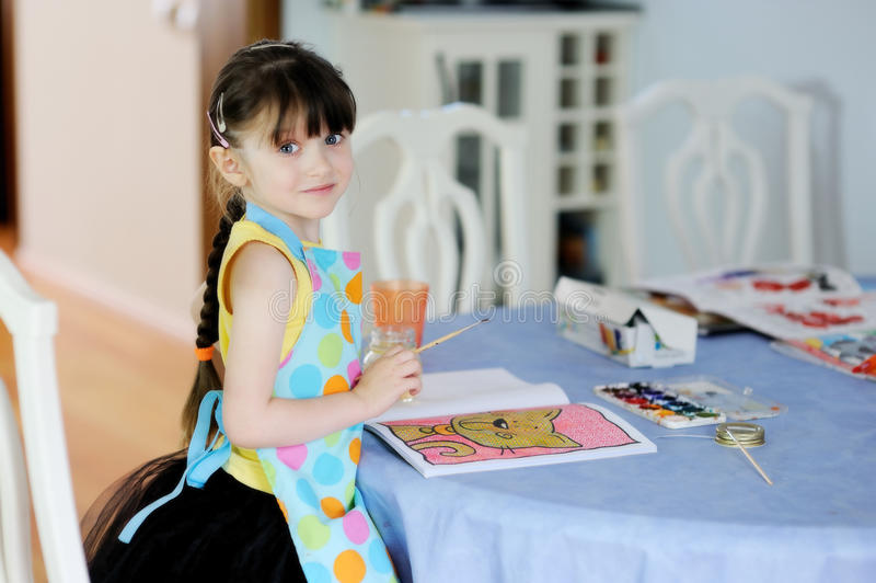 Download Adorable Little Girl With Long Dark Hair Draws Stock Image - Image: 17884957