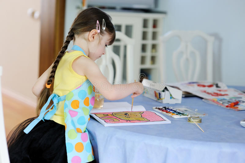 Download Adorable Little Girl With Long Dark Hair Draws Stock Photo - Image: 17884972