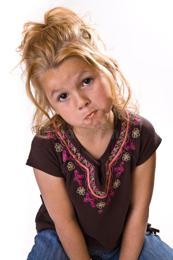 Adorable little girl looking sad. Cute young girl begging or saying please stock image