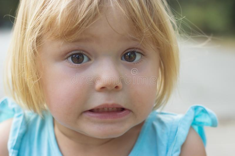 Adorable little girl making disgusted or surprised face stock photography