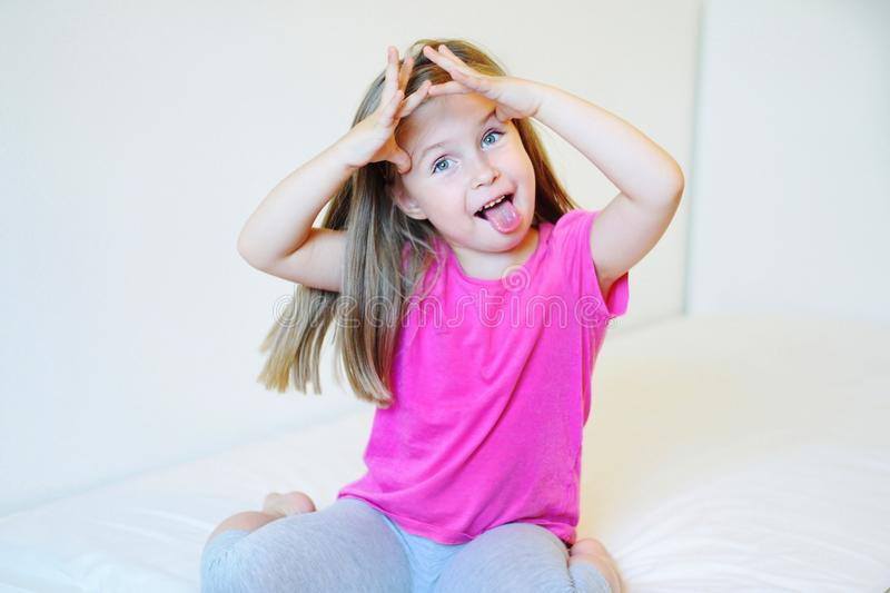 Adorable little girl making funny faces royalty free stock images
