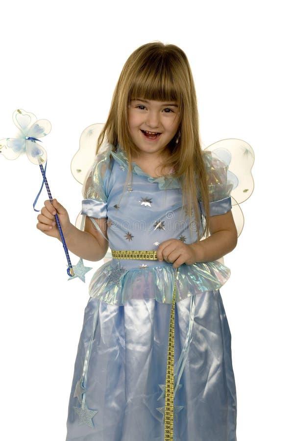 Adorable little girl measuring waist stock photography
