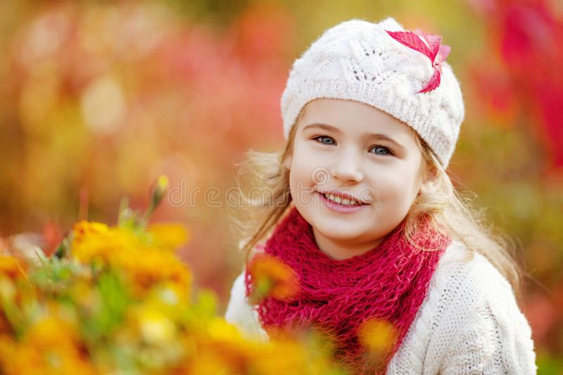 Adorable little girl outdoors at beautiful autumn day. Autumn activities for children. Halloween and Thanksgiving time fun for stock photography