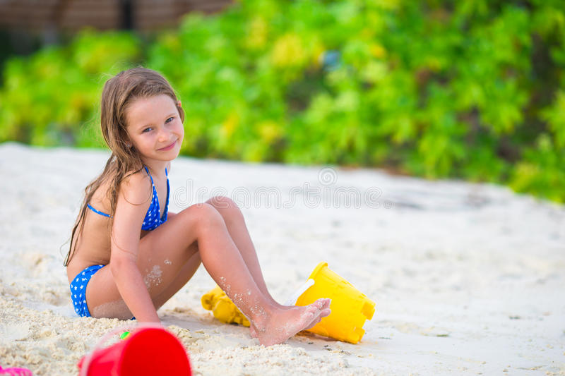 Beach Toys For Girls : Adorable little girl playing with beach toys stock image