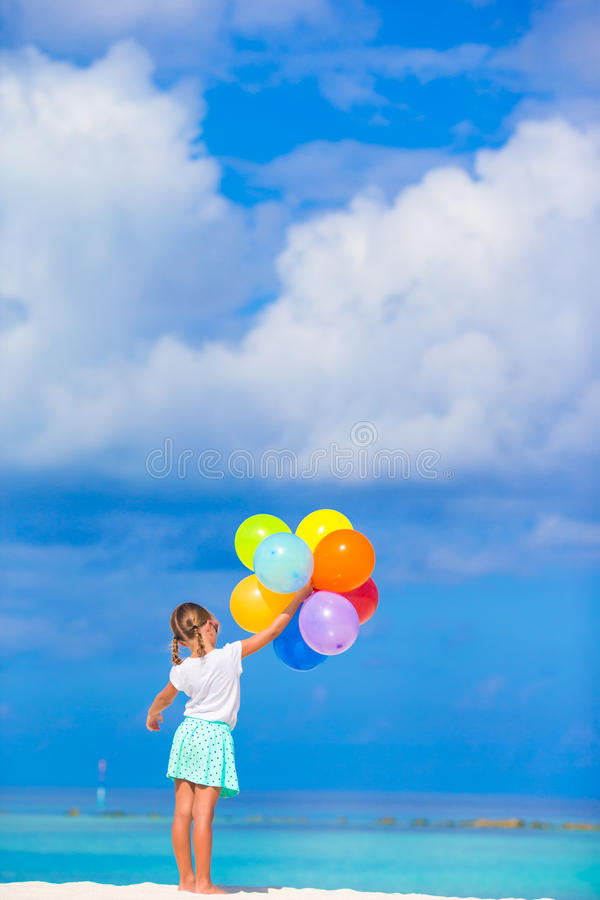 Free Adorable Little Girl Playing With Balloons At The Stock Images - 53405114