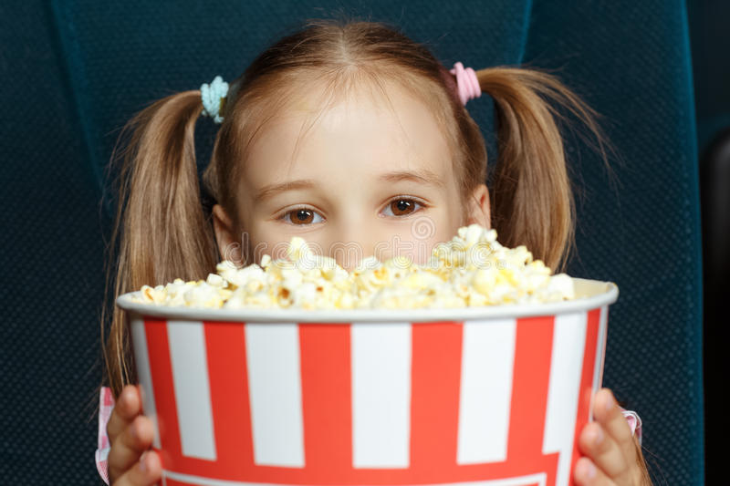 Adorable little girl with popcorn royalty free stock images