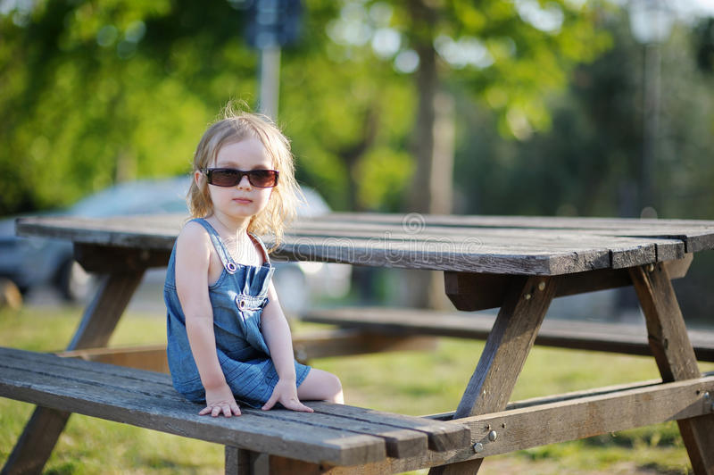 Download Adorable Little Girl Sitting On A Bench Stock Image - Image: 20586115