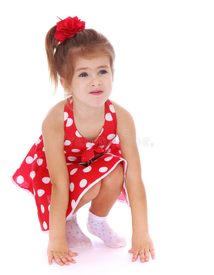 Adorable little girl squatted stock images