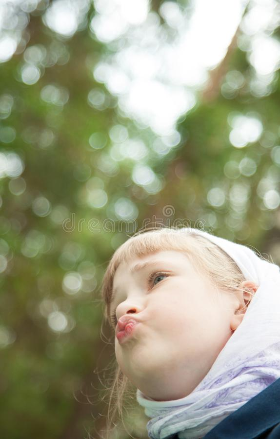 Adorable little girl in a summer park stock photos