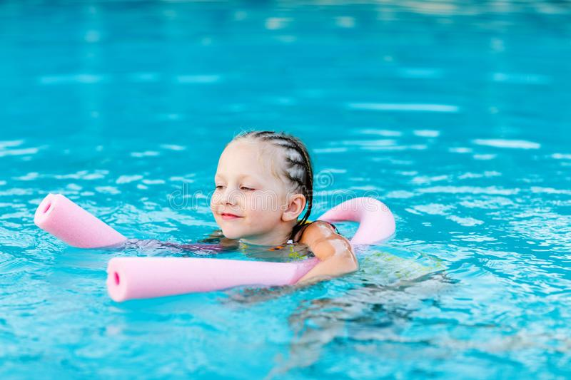 Little girl at swimming pool. Adorable little girl at swimming pool royalty free stock photo