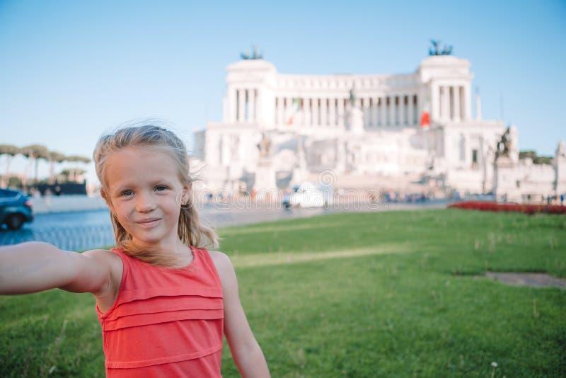 Adorable little girl taking selfie in front of Altare della Patria, Vittoriano, Rome, Italy. Adorable little girl taking selfie in front of Altare della Patria stock image