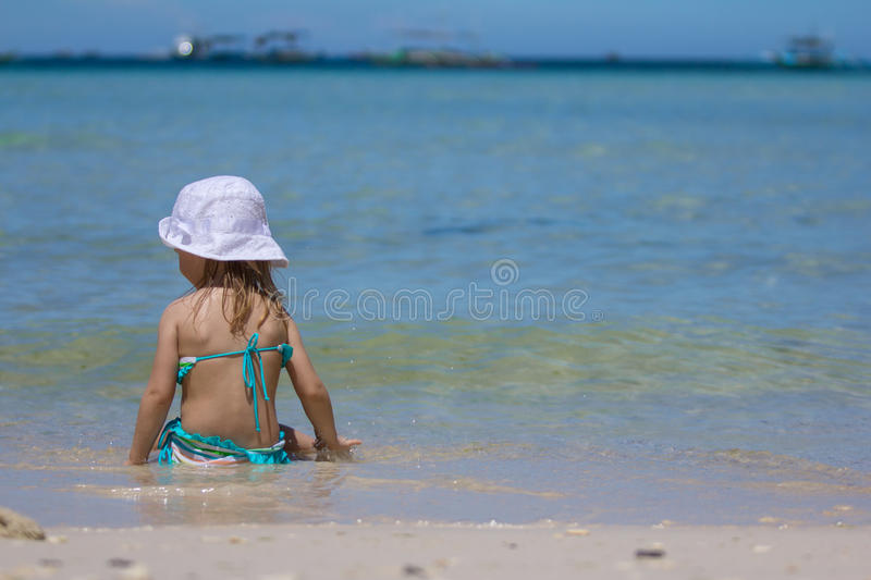 Adorable little girl on tropical beach vacation royalty free stock photography