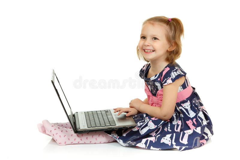 Adorable little girl using laptop stock photo