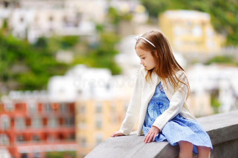 Adorable little girl on warm and sunny summer day in Positano town stock images