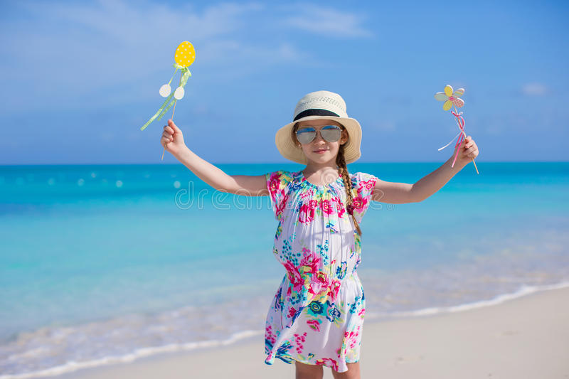 Adorable little girl at white beach during summer vacation stock photo