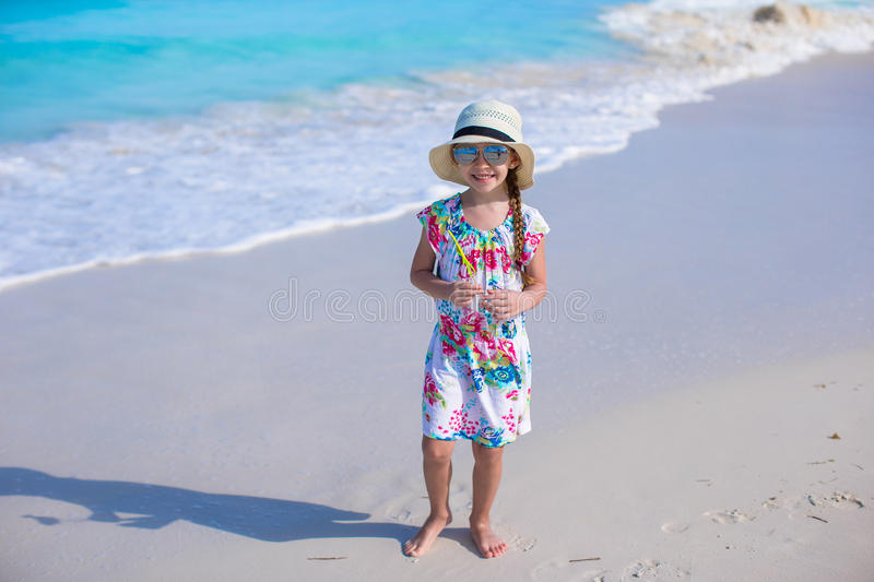 Adorable little girl at white beach during summer stock photography