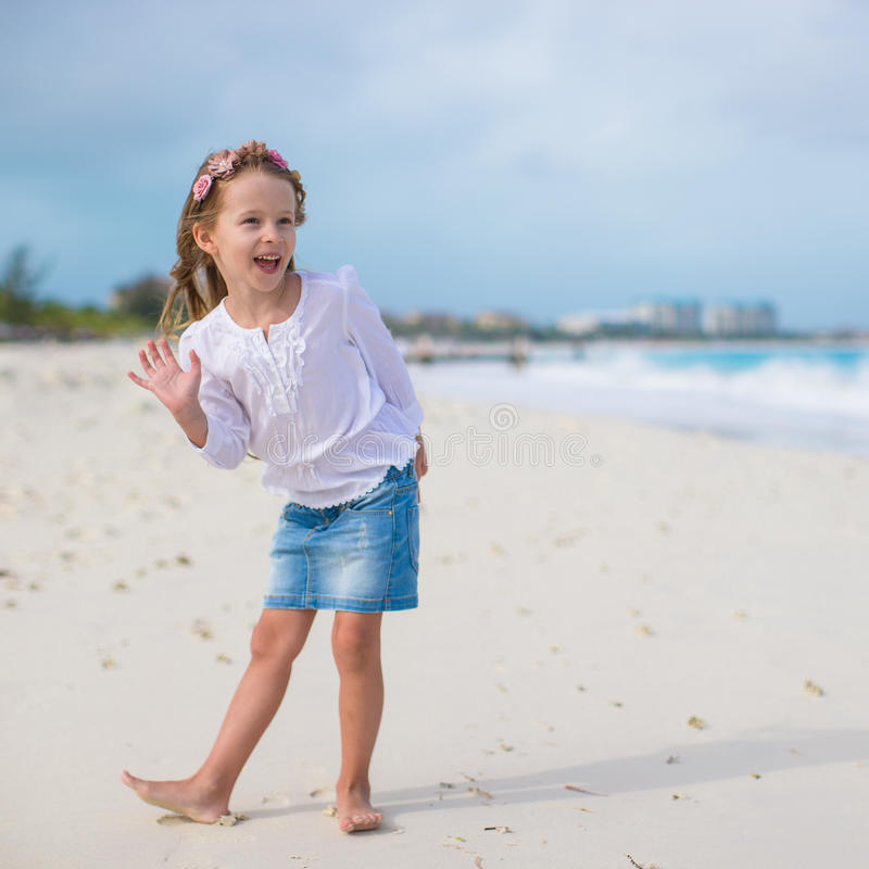Adorable little girl at white beach during summer royalty free stock photo