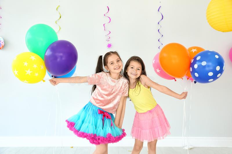 Adorable little girls at birthday party indoors stock photography