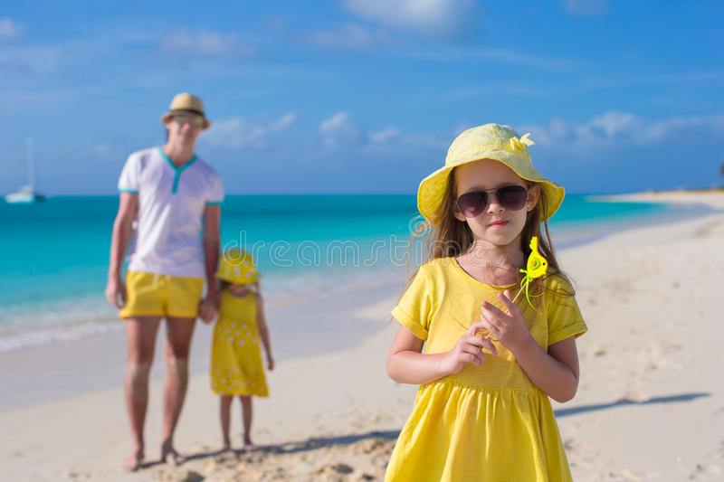 Adorable little girls and happy father on tropical stock photos