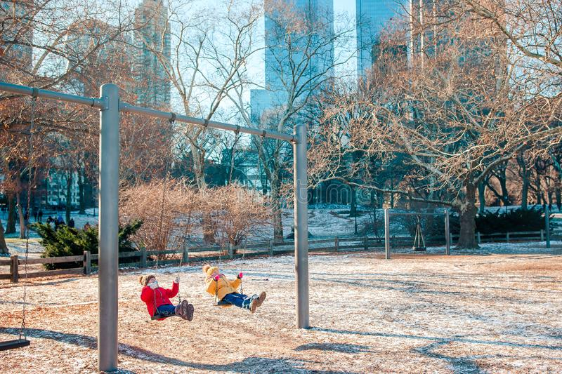 Adorable little girls having fun in Central Park at New York City stock photo