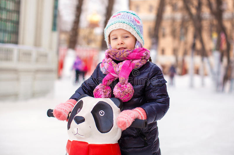 Adorable little happy girl skating on the ice-rink. This image has attached release royalty free stock images
