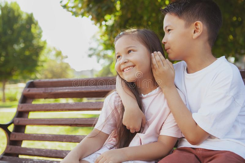 Adorable little kids enjoying warm sunny day at the park royalty free stock image