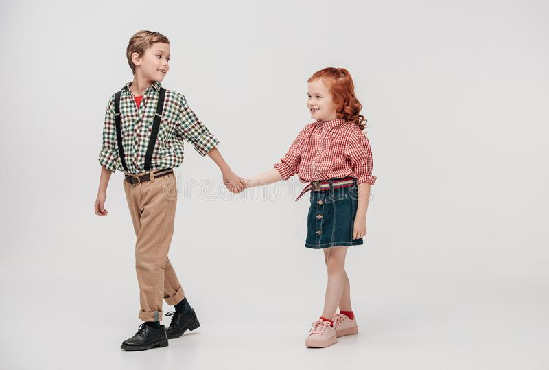 adorable little kids holding hands and walking together royalty free stock images